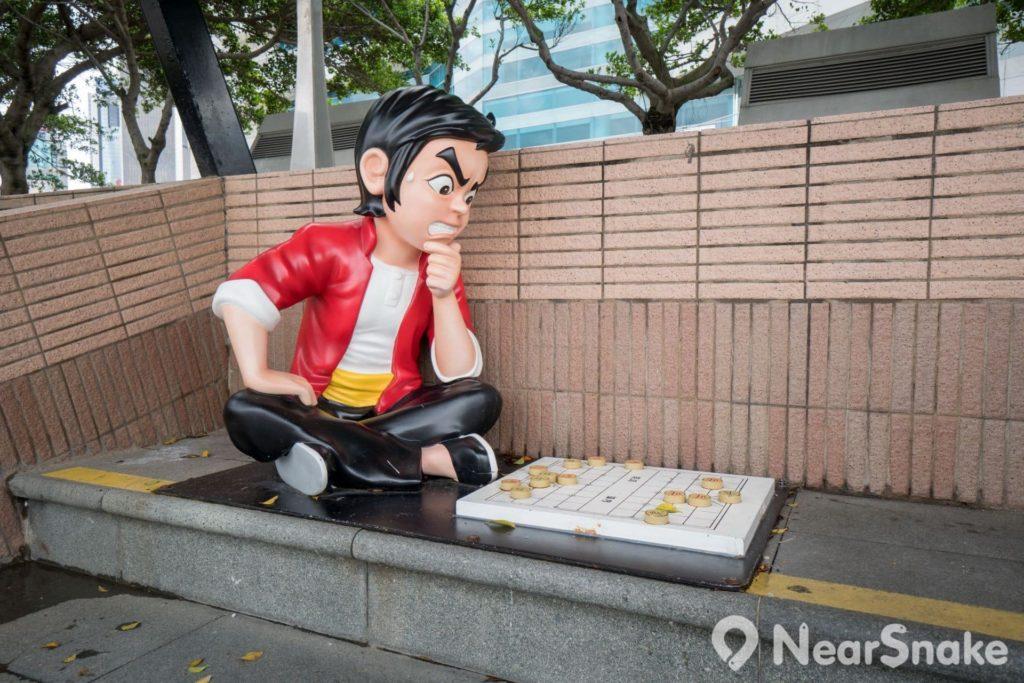 香港動漫海濱樂園: 王小虎玩捉棋?錯姿勢喎!給他一個神龍擺尾或電光獨龍鑽,踢醒他啦!
