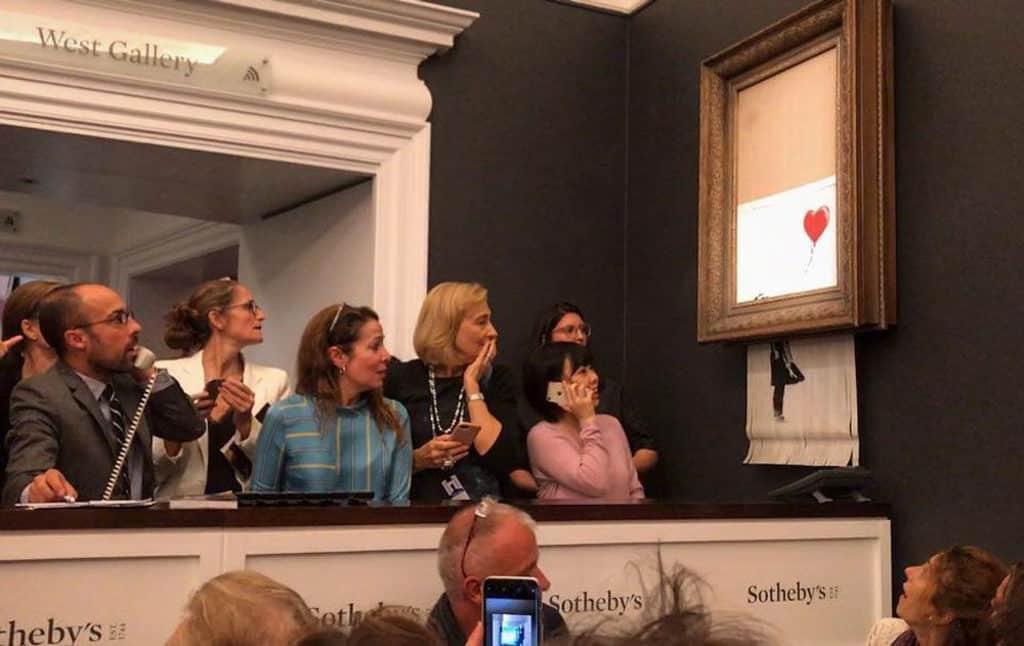 Banksy: Who's Laughing Now香港展售會 複印作品《Girl with Balloon》早前在倫敦拍賣成交後,被內置碎紙機弄碎。
