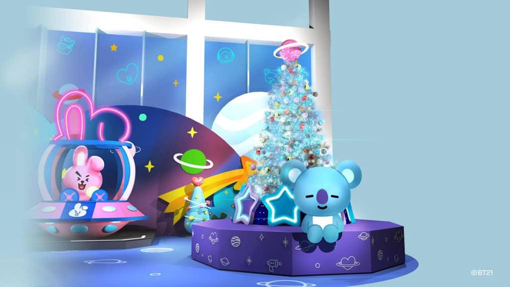 BT21 MEETS The ONE 冬日夢幻漫遊宇宙 KOYA 將宇宙閃亮聖誕樹掛滿聖誕掛飾。